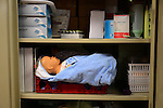 A baby mannequin is stored in a supply closet at the Frontier Nursing University in Hyden, Kentucky, on Friday October 11, 2013. Frontier Nursing University was founded in 1939. Photo by Eleanor Hasken