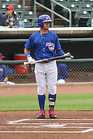 Iowa Cubs shortstop Javier Baez (9) steps to the plate during a Pacific Coast League game against the Colorado Springs Sky Sox on May 10th, 2015 at Principal Park in Des Moines, Iowa.  Iowa defeated Colorado Springs 14-2.  (Brad Krause/Four Seam Images)