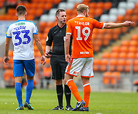 Referee Ross Joyce has words with Blackpool's Chris Taylor and Portsmouth's Ben Close<br /> <br /> Photographer Alex Dodd/CameraSport<br /> <br /> The EFL Sky Bet League One - Blackpool v Portsmouth - Saturday August 11th 2018 - Bloomfield Road - Blackpool<br /> <br /> World Copyright &copy; 2018 CameraSport. All rights reserved. 43 Linden Ave. Countesthorpe. Leicester. England. LE8 5PG - Tel: +44 (0) 116 277 4147 - admin@camerasport.com - www.camerasport.com