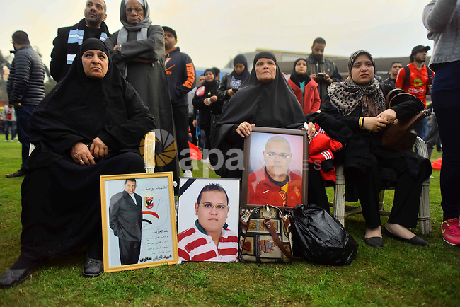 """Relatives of al-Ahly fans, who were killed in what known as the """"Port Said massacre"""", attend the fourth anniversary of killing their relatives at al-Ahly club's training stadium, on February 1, 2016. On 1 February 2012, a massive riot occurred at Port Said Stadium in Port Said city, Egypt, following an Egyptian Premier League football match between El Masry and El Ahly clubs. At least 74 people were killed and more than 500 were injured after thousands of El Masry spectators stormed the stadium stands and the pitch. Photo by Amr Sayed"""