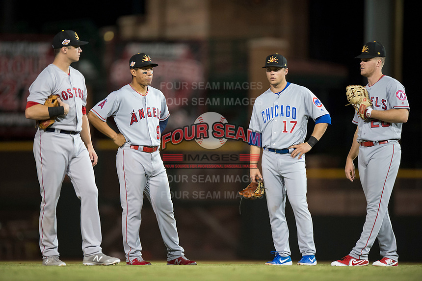 Mesa Solar Sox infielders Bobby Dalbec (11), Jahmai Jones (9), Nico Hoerner (17), and David MacKinnon (20) during a pitching change in an Arizona Fall League game against the Scottsdale Scorpions on October 9, 2018 at Scottsdale Stadium in Scottsdale, Arizona. The Solar Sox defeated the Scorpions 4-3. (Zachary Lucy/Four Seam Images)