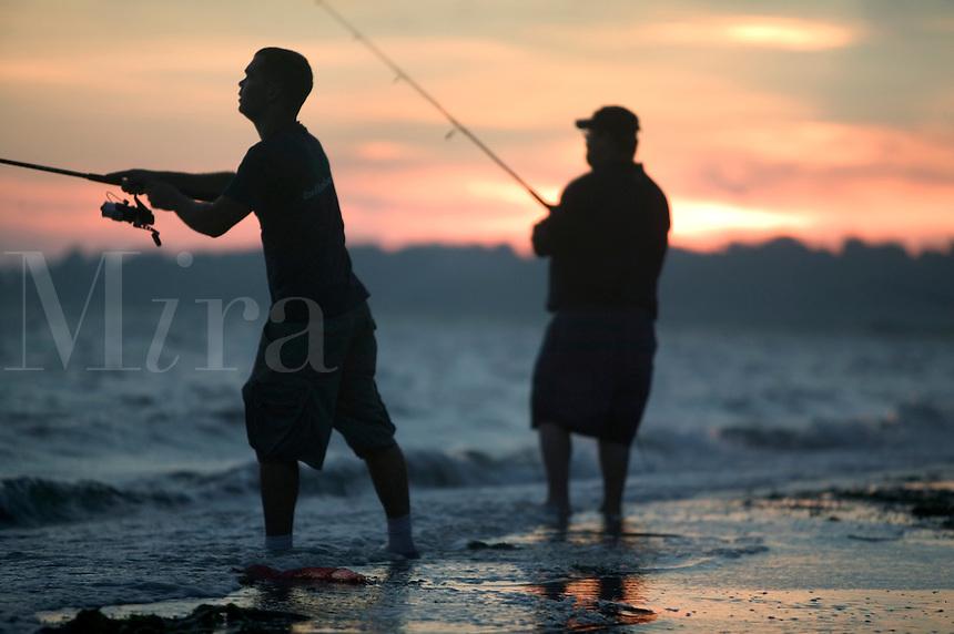 Recreational fishermen at sunset. Barrington Beach on Narragansett Bay, Barrington, Rhode Island.