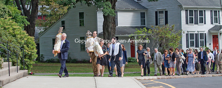 CHESHIRE CT.-04 SEPTEMBER 2013 090413DA02- Temple Beth David held Rosh Hashanah services at First Congregational Church in Cheshire Thursday morning. The Temple's Torahs was carried from the Temple at 3 Main Street to the First Congregational Church by members of the Temple. The temple's congregation wanted a space to celebrate the holiday as one congregation after two decades of praying in two groups. The church has agreed to remove its only cross from its sanctuary to accommodate the temple's congregation.<br /> Darlene Douty Republican American