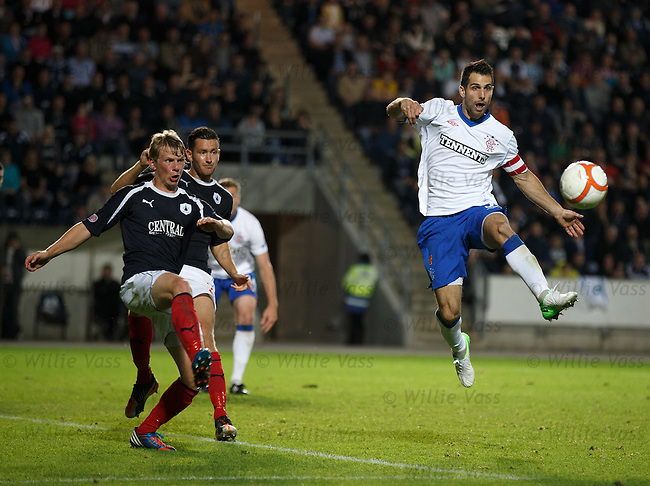 Carlos Bocanegra hoofs the ball clear