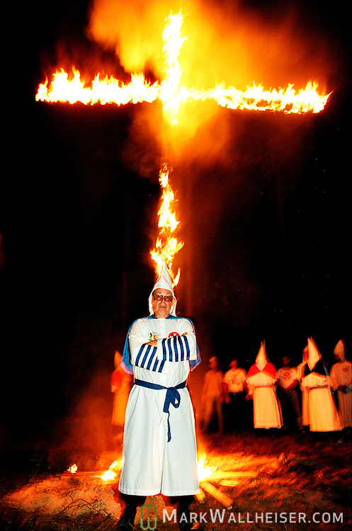 The Imperial Wizard of the Florida Klavern of the Invisible Empire of the Knights of the Klu Klux Klan poses for a photograph during his group's ceremonial cross lighting in Gadsden County, Florida north of Tallahassee May 26,1990.