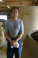 Potter Yukio Mori at his Otani pottery workshop, Naruto, Tokushima Prefecture, Japan, July 8, 2014. The city of Naruto in Tokushima Japan is famous for whirlpools that form in the Naruto Strait. It is home to Otani pottery and the first two temples on the Shikoku 88 temple pilgrimage.