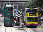 Doubledecker bus and tram in Hongkongs Central District.