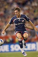 New England Revolution midfielder Andy Dorman (25) leaps high to trap the ball. The New England Revolution defeated the Colorado Rapids, 1-0, at Gillette Stadium in Foxboro, MA on September 29, 2007.