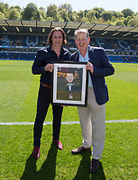 Wycombe Wanderers Manager Gareth Ainsworth presents BBC Presenter & Wycombe supporter Bill Turnbull with a caricature during the Sky Bet League 2 match between Wycombe Wanderers and Stevenage at Adams Park, High Wycombe, England on 5 May 2018. Photo by Kevin Prescod.