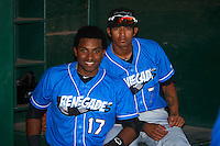 Hudson Valley Renegades Manny Sanchez (17) and Jose Paez (7) in the dugout before a game against the Vermont Lake Monsters on September 3, 2015 at Centennial Field in Burlington, Vermont.  Vermont defeated Hudson Valley 4-1.  (Mike Janes/Four Seam Images)