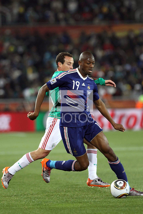 Gerardo Torrado (R) Mexico and Abou Diaby (L) of France