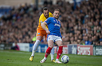 Ben Davies of Portsmouth holds off Paul Hayes of Wycombe Wanderers during the Sky Bet League 2 match between Portsmouth and Wycombe Wanderers at Fratton Park, Portsmouth, England on 23 April 2016. Photo by Andy Rowland.