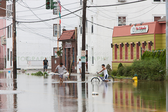 MAMARONECK, NY - AUGUST 28: Local residents negotiate high water on flooded Mamaroneck Avenue in the Village of Mamaroneck, New York on Sunday August 28, 2011 in the aftermath of Hurricane Irene.