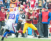 Washington Redskins running back Matt Jones (31) carries the ball in the fourth quarter against the Buffalo Bills at FedEx Field in Landover, Maryland on Sunday, December 20, 2015.  The Redskins won the game 35-25.<br /> Credit: Ron Sachs / CNP