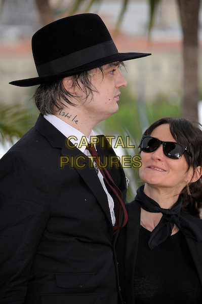 Pete Doherty, Sylvie Verheyde.'Confessions of a Child of the Century' photocall at the 65th  Cannes Film Festival, France 20th May 2012..half length black hat red tie suit white shirt silver chain necklace side sunglasses profile astile tattoo on neck (son's name).CAP/PL.©Phil Loftus/Capital Pictures.