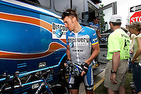 Yaroslav Popovych of the Discovery Channel Pro Cycling Team walks to his bike before Stage 2 of the 2006 Ford Tour de Georgia pro cycling race. Popovych won the 116.1-mile stage from Fayetteville to Rome in 4:47:39.<br />