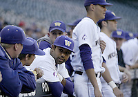 03 April 2009:  Washington's #21 Caleb Brown (right) chats with teammates along the top stair of the dug out before the game against Arizona State at Safeco Field in Seattle, WA.  Arizona State won 3-1 over Washington.