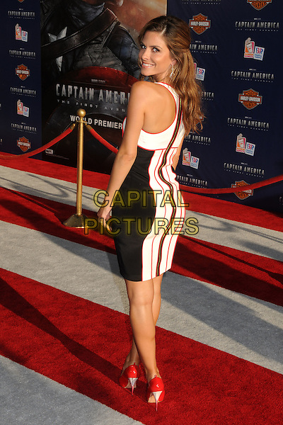 "Maria Menounos.Premiere of ""Captain America: The First Avenger"" held at The El Capitan Theatre in Hollywood, California, USA..July 19th, 2011.full length white red black dress striped stripes back behind rear sleeveless looking over shoulder .CAP/ADM/BP.©Byron Purvis/AdMedia/Capital Pictures."