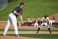 Christian Long (19) of the Wake Forest Demon Deacons takes his lead off of first base as Virginia Cavaliers pitcher Bennett Sousa (11) looks to his catcher for the sign at David F. Couch Ballpark on May 19, 2018 in  Winston-Salem, North Carolina. The Demon Deacons defeated the Cavaliers 18-12. (Brian Westerholt/Four Seam Images)