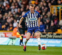 7th March 2020; Molineux Stadium, Wolverhampton, West Midlands, England; English Premier League, Wolverhampton Wanderers versus Brighton and Hove Albion; Dan Burn of Brighton & Hove Albion flicks a pass with the outside of his left boot