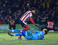 Cheltenham Town's Scott Flinders denies Lincoln City's Matt Green<br /> <br /> Photographer Andrew Vaughan/CameraSport<br /> <br /> The EFL Sky Bet League Two - Lincoln City v Cheltenham Town - Tuesday 13th February 2018 - Sincil Bank - Lincoln<br /> <br /> World Copyright &copy; 2018 CameraSport. All rights reserved. 43 Linden Ave. Countesthorpe. Leicester. England. LE8 5PG - Tel: +44 (0) 116 277 4147 - admin@camerasport.com - www.camerasport.com