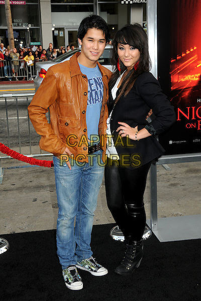 "BOOBOO & FIVEL STEWART .""A Nightmare On Elm Street"" Los Angeles Premiere held at Grauman's Chinese Theatre, Hollywood, California, USA, 27th April 2010..full length black jacket blazer hand on hip leather rubber leggings lace-up ankle boots brother family sister siblings brown tan jeans trainers blue t-shirt .CAP/ADM/BP.©Byron Purvis/AdMedia/Capital Pictures."