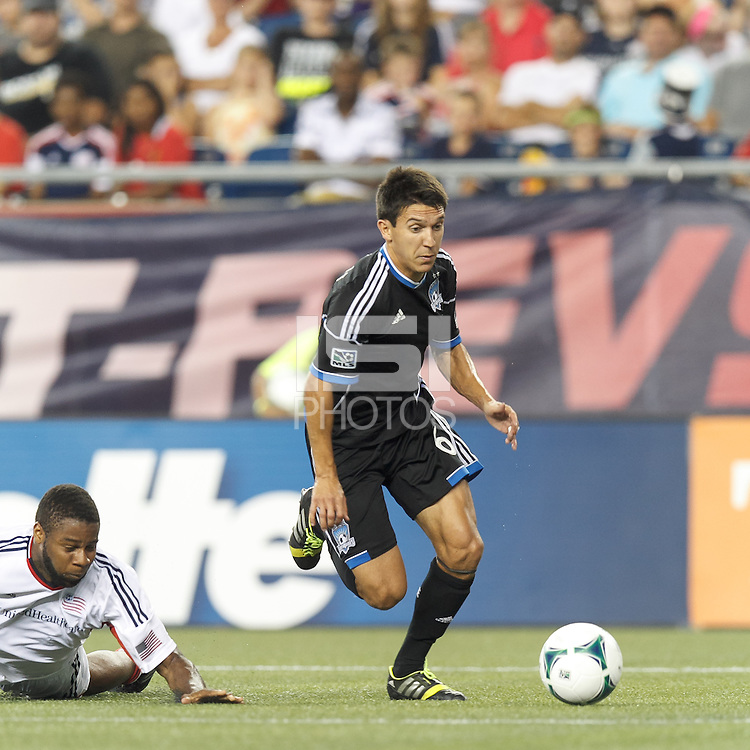 San Jose Earthquakes midfielder Shea Salinas (6) on the attack.  In a Major League Soccer (MLS) match, the New England Revolution (white) defeated San Jose Earthquakes (black), 2-0, at Gillette Stadium on July 6, 2013.
