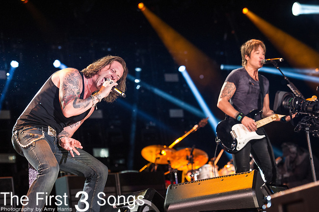 Keith Urban performs with Tyler Hubbard of Florida Georgia Line at LP Field during Day Three of the 2014 CMA Music Festival in Nashville, Tennessee.
