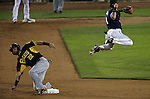 Reno Aces&rsquo; Ildemaro Vargas puts out Salt Lake Bees&rsquo; Kaleb Cowart at Greater Nevada Field, in Reno, Nev., on Monday, Aug. 10, 2016. <br />