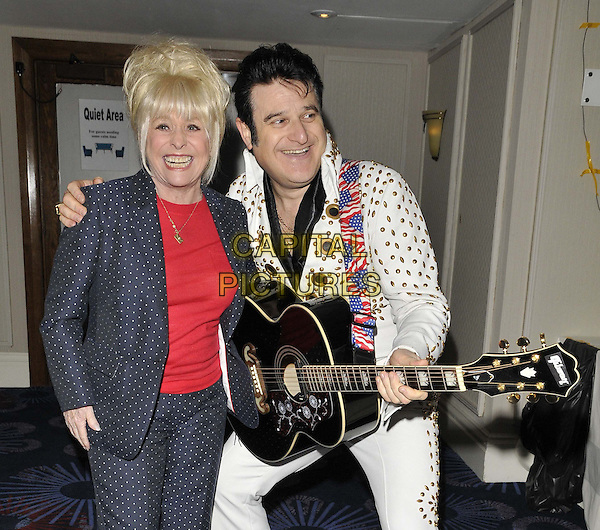 LONDON, ENGLAND - JANUARY 19: Barbara Windsor &amp; Elvis lookalike at the Mad Hatter's Tea Party organised by the London Taxi Drivers' Fund to help underprivileged children, Grosvenor House Hotel, Park Lane, on Sunday January 19, 2014 in London, England, UK. <br /> CAP/CAN<br /> &copy;Can Nguyen/Capital Pictures