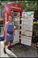 BNPS.co.uk (01202 558833)<br /> Pic: AmberleyPublishing/BNPS<br /> <br /> Ben Spier stood next to his K6 salad bar kiosk in Bloomsbury Square, Holborn.<br /> <br /> The iconic British phonebox has been given a ringing endorsement in a new book charting the expiring institution's fascinating history. <br /> <br /> Aptly titled 'The British Phonebox', the book primarily focuses on the ubiquitous design that's as emblematic to Britain as the black cab, double decker bus and Houses of Parliament. <br /> <br /> Equally interesting are the early chapters, which detail the phonebox's humble 19th century beginnings and the final ones, that bemoan their dwindling numbers <br /> <br /> The 96 page paperback, jointly authored by friends Nigel Linge and Andy Sutton, is published by Amberley and costs &pound;13.49.
