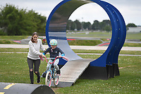Jenna Dick of Bentonville helps her daughter Madelyn Dick, 9, negotiate the ramps at Runway Bike Park in Springdale Wednesday May 20, 2020. The park is a 2.75 acre outdoor bicycle skills training area located at The Jones Center, just north of the Springdale Municipal Airport. Visit nwaonline.com/200521Daily/  for photo galleries. (NWA Democrat-Gazette/J.T. Wampler)