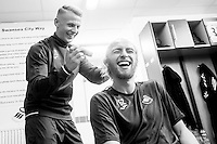 Thursday  13 October 2014<br /> Pictured: Stephen Kingsley shaves Oliver McBurnie's head <br /> Re: Swansea Striker Oli Mcburnie's friend Joshua Hutchinson has recently suffered from cancer and received support from Macmillan. Oli, together with friends have shaved their heads in the hope to raise as much money as possible for the charity Oli's hair was shaved by Swans winger Stephen Kingsley at the Fairwood training ground, Swansea, Wales, UK
