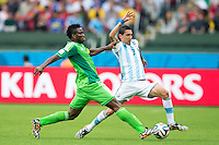 Angel Di Maria of Argentina and Kenneth Omeruo of Nigeria
