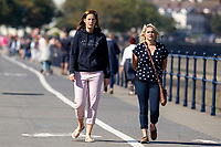 Pictured: Two ladies walking during the sunny weather at Mumbles, near Swansea, Wales, UK. Thursday 19 September 2019