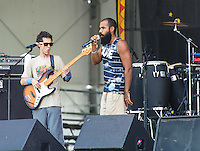 Baiana System performs at the 2014 Jazz and Heritage Festival in New Orleans, LA.