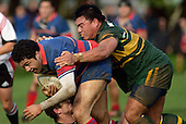 R Afoa Peterson is tackled by K. Farrell & S. Tualaulelei. Counties Manukau Premier Club Rugby, Pukekohe v Ardmore Marist played at the Colin Lawrie field, on the 27th of May 2006.Ardmore Marist won 22 - 6