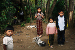 GUATEMALA  --  FEBRUARY 5, 2007:   Miguel (L) stands with Eva Catarina Ceto Depaz (C),  Catarina Ceto Depaz (2R) and Pablo Fernando Ceto Depaz (R) in front of their house on February 5, 2007 in Nebaj, Guatemala.  (PHOTOGRAPH BY MICHAEL NAGLE)