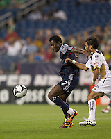 New England Revolution forward Kenny Mansally (7) attempts to control the ball as Pumas UNAM midfielder Jehu Chiapas (13) defends. The New England Revolution defeated Pumas UNAM in SuperLiga group play, 1-0, at Gillette Stadium on July 14, 2010.