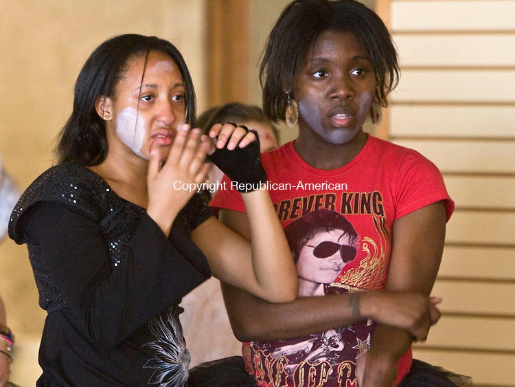 WATERBURY, CT - 03 MAY 2010 -050210JT08-<br /> Dance student CharJohna Cam, 18, of Waterbury, holds back tears as she and Tiffany Robinson, 15, also of Waterbury, gaze at Michael Jackson impersonator Joby Rogers during a class in the &quot;Thriller&quot; routine on Sunday at the Howland Hughes building in Waterbury for Connecticut Dance Theatre in celebration of National Dance Week.<br /> Josalee Thrift Republican-American