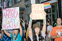 "Counterprotesters hold signs toward, flip-off, and angrily shout at those marching in the Straight Pride Parade in Boston, Massachusetts, on Sat., August 31, 2019. The parade was organized in reaction to LGBTQ Pride month activities by an organization called Super Happy Fun America. The people's signs here read ""Make America Gay Again"" and ""Homo Phobia Kills."""