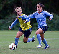 USWNT midfielder Lori Lindsey fights for the ball with defender Stephanie Cox during practice in Chester, PA.  The USWNT will take on China, in an international friendly at PPL Park, on October 6.