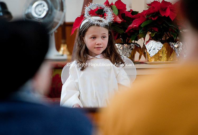 BARKHAMSTED,  CT-122114JS08- Rachael Rhodes, 7, of Winsted, played and Angel during the17th annual Christmas Pageant held Sunday at the First Congregational Church of Barkhamsted. <br /> Jim Shannon Republican-American