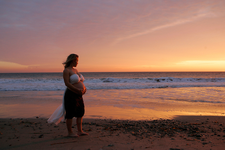 Portrait of a pregnant woman on the beach in Malibu, California.