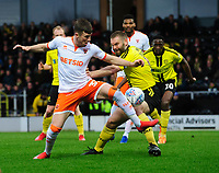 Blackpool's Chris Long vies for possession with Burton Albion's Jake Buxton<br /> <br /> Photographer Chris Vaughan/CameraSport<br /> <br /> The EFL Sky Bet League One - Burton Albion v Blackpool - Saturday 16th March 2019 - Pirelli Stadium - Burton upon Trent<br /> <br /> World Copyright &copy; 2019 CameraSport. All rights reserved. 43 Linden Ave. Countesthorpe. Leicester. England. LE8 5PG - Tel: +44 (0) 116 277 4147 - admin@camerasport.com - www.camerasport.com