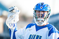 Steven Russell,'15, cheers for his teammates as the Salve Regina men's lacrosse team dominates Anna Maria at Gaudet Field in Middletown.