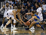 Nevada forward Trey Porter (15) and San Jose State guard Brae Ivey (2)  go after a loose ball in the first half of an NCAA college basketball game in Reno, Nev., Wednesday, Jan. 9, 2019. (AP Photo/Tom R. Smedes)