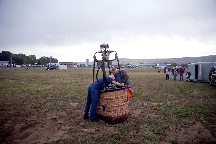 Balloon owners put away a balloon basket after landing at the Great Prosser Balloon Rally in Prosser, Washington, USA.