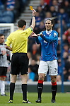 Bilel Mohsni booked by ref Kevin Clancy after a tackle on Ross Forbes