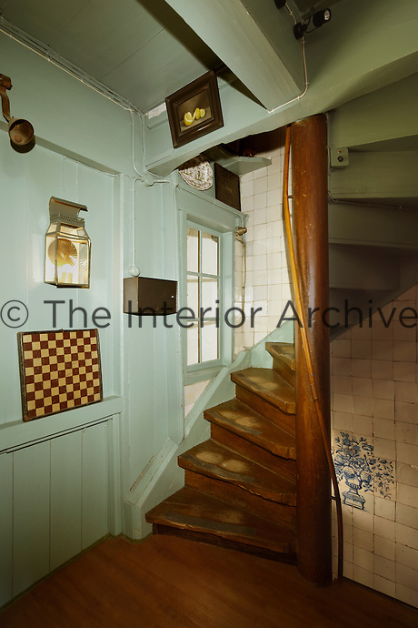 A winding 17th century staircase leads up from the oak panelled first floor landing